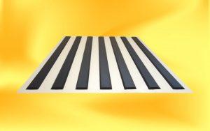 Bílý vodící pás s černými proužky